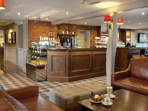 The lounge or bar area at Macdonald Tickled Trout Hotel