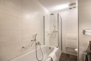 A bathroom at Van der Valk Hotel Den Haag - Voorschoten