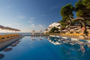 Het zwembad bij of vlak bij htop Caleta Palace