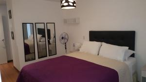 A bed or beds in a room at Miraflores 820