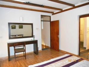 A television and/or entertainment center at 1 Br Apartment 2-4 in 7HCR Residencies