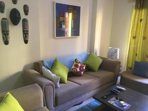 Svetainės erdvė apgyvendinimo įstaigoje Pool View Apartment at British Resort - Unit 02
