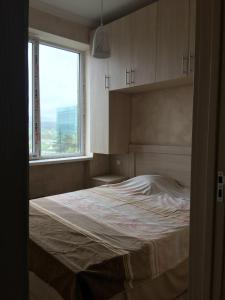 A bed or beds in a room at Check In Imereti