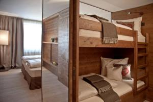 A bunk bed or bunk beds in a room at Ariston Dolomiti Residence