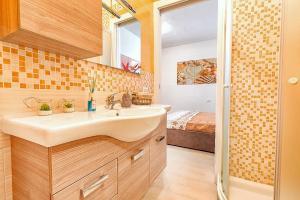 Ein Badezimmer in der Unterkunft Appartamento con Spiaggia Privata Wi-fi Parking