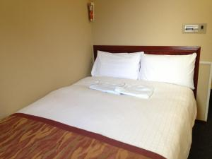 A bed or beds in a room at Hotel Horidome Villa