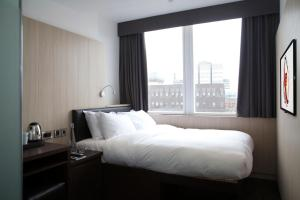 A bed or beds in a room at The Z Hotel Liverpool