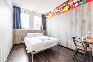 A bed or beds in a room at Euro Hostel Glasgow