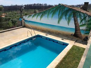 The swimming pool at or near SOLAR DA SERRA-GuestHouse