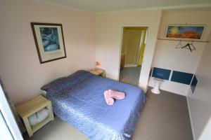 A bed or beds in a room at Funky Green Voyager Backpackers