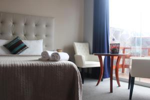 A bed or beds in a room at Gran Hotel Villa del Sur