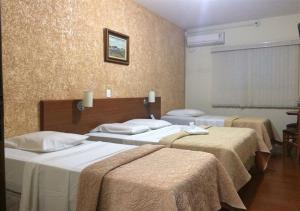 A bed or beds in a room at Hotel Rafeli