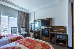 A television and/or entertainment center at Petra Moon Hotel