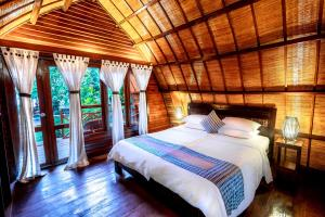 A bed or beds in a room at Manta Dive Gili Air Resort