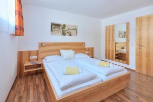 Ein Bett oder Betten in einem Zimmer der Unterkunft Apart Bellevue