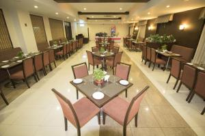 A restaurant or other place to eat at Hotel Grand International