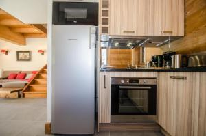 A kitchen or kitchenette at Chalet Panorama