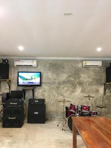 A television and/or entertainment center at Baan Suan Kru Kob
