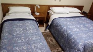 A bed or beds in a room at Hotel Panorama