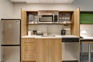 A kitchen or kitchenette at Home2 Suites By Hilton Montreal Dorval