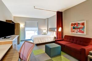 A television and/or entertainment center at Home2 Suites By Hilton Montreal Dorval