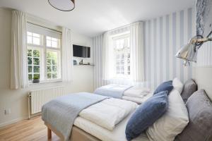 En eller flere senge i et værelse på Gl. Avernæs Sinatur Hotel & Konference