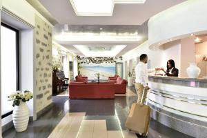 The lobby or reception area at Orrì Hotel
