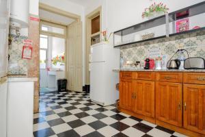 O bucătărie sau chicinetă la Unique Lisbon Rooms