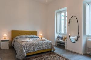 A bed or beds in a room at Nonna Vittoria Apartment