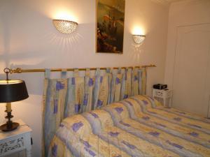 Un ou plusieurs lits dans un hébergement de l'établissement Residence Le Minerve