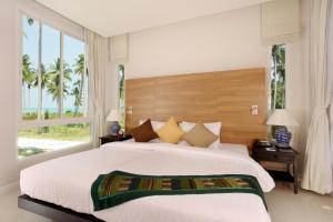 Voodi või voodid majutusasutuse Kantary Beach Hotel Villas & Suites toas