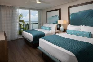 A bed or beds in a room at The Laureate Key West