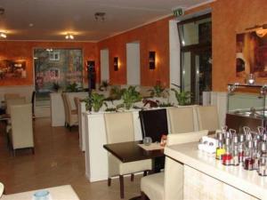 Reštaurácia alebo iné gastronomické zariadenie v ubytovaní Hotel Galileo