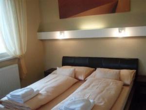 Posteľ alebo postele v izbe v ubytovaní Hotel Galileo