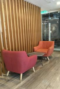 Ein Sitzbereich in der Unterkunft Hotel Transit Kuala Lumpur