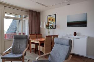 Ein Sitzbereich in der Unterkunft Appartementen Amelander Paradijs