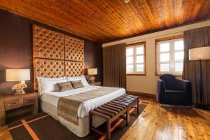 Uma cama ou camas num quarto em Luna Hotel Serra da Estrela