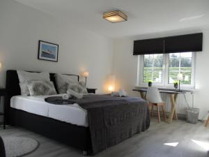 A bed or beds in a room at Best Pension
