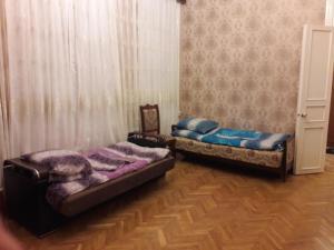 Cama ou camas em um quarto em Guiet Center Apartment