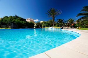 The swimming pool at or near Hotel Luci Del Faro