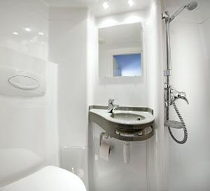 Een badkamer bij Bud Gett Hostels