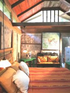 Area soggiorno di Tortugal Boutique River Lodge