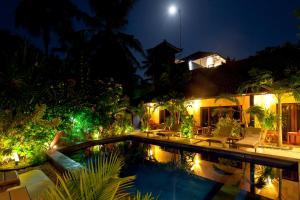 The swimming pool at or near Senang Villa