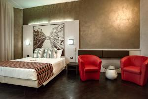 A bed or beds in a room at Hotel Milano Navigli