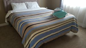 A bed or beds in a room at Rainbow home