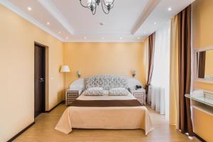 Кровать или кровати в номере Гостиничный Комплекс Парк - Отель Пушкин