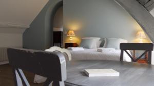 Un ou plusieurs lits dans un hébergement de l'établissement LE MOULIN DE L'ORTILLE
