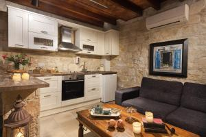 A kitchen or kitchenette at Oinoessa Traditional Boutique Guest Houses