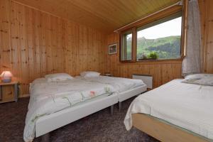 A bed or beds in a room at Motel Bivouac de Napoléon