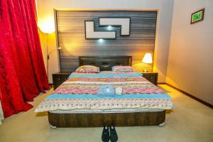 Cama ou camas em um quarto em Apartment With Sauna 4 Bedrooms